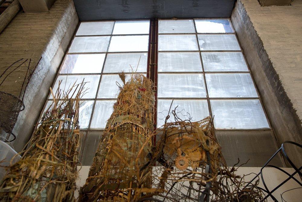 Willow sculpture in front of artist studio windows at Waltham Mills